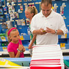 SAM HOUSEHOLDER | THE GOSHEN NEWS<br /> Richard Darling, right, consults his back to school list on his cell phone while daughter Kierstan, 11 and friend Destinee Bornkamp, 13, pick out supplies at Target Tuesday. The two girls will be attending NorthWood Middle School this fall.