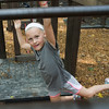 SAM HOUSEHOLDER | THE GOSHEN NEWS<br /> Anna Marinier, 7, Villa Park, Ill. climbs across monkey bars at Tommy's Kidz Castle in Shanklin Park Wednesday in Goshen.