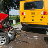 SAM HOUSEHOLDER | THE GOSHEN NEWS<br /> A Goshen school bus was struck Friday afternoon in the 21000 block of C.R. 36 west of Goshen. According to Elkhart County police the bus was headed eastbound on C.R. 36 between Ind. 119 and C.R. 19 when it stopped to drop off its last two students. Police said that the bus had its stop signs deployed and lights on when a truck also travelling eastbound struck the back of the bus. No injuries were reported, the driver of the bus, the two students, from Waterford Elementary School and the driver of the truck were checked out by Elkhart Township EMS and released. The bus was brand new according to officials at the scene, having just gone into service yesterday. Police said the driver of the truck said he didn't see the bus stopped because of the bright sunlight.