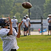 SAM HOUSEHOLDER | THE GOSHEN NEWS<br /> Kaleb Rodriguez, a freshman, catches a pass during Fairfield High School football practice Tuesday. The Falcons open their season on Aug. 22 at Mishawaka Marian.