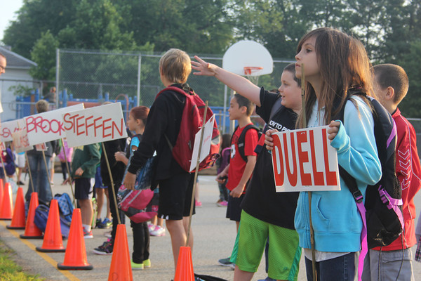 JULIE CROTHERS | THE GOSHEN NEWS<br /> Cehcily Gerardot, 8, waits in line for her first day of third grade Thursday at Parkside Elementary School as her classmate Carter Yoder, 8, waves his hands and cheers.
