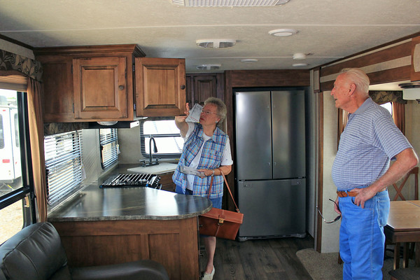 Roger Schneider | The Goshen News<br /> CAROLE BRONICKI looks at the cabinets inside a Sprinter fifth wheel recreational vehicle Thursday at the Midwest RV Super Show while her husband Ray looks on.