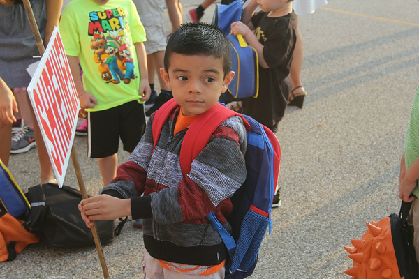 JULIE CROTHERS | THE GOSHEN NEWS<br /> Edward Moreno, 5, watches other students as he waits in line for the first day of kindergarten to begin Thursday at Parkside Elementary School.