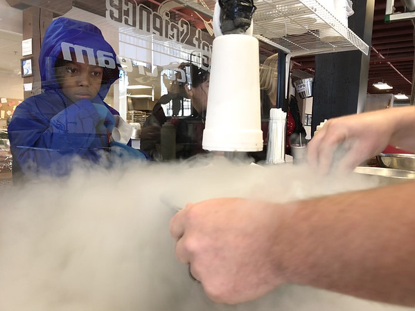 JAY YOUNG | THE GOSHEN NEWS<br /> Goshen Middle School sixth grade student Jeremiah Starks watches intently as liquid nitrogen turns his liquid ice cream mixture to a frozen solid in a matter of seconds right before his eyes on Thursday morning at Rocket Science Ice Cream in Nappanee. Students in the new tech program have spent the past two weeks learning about the different states of matter. As part of the class, students created their own unique flavors of ice cream and took a field trip to the ice cream shop to watch their recipes change from liquid to solid state.