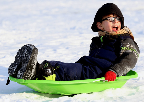 "JAY YOUNG | THE GOSHEN NEWS<br /> Seven-year-old Owen Higginbotham lets out a scream as he rides his plastic sled down the snow covered hill at Abshire Park on Wednesday afternoon. Owen along with his brother Ian went sledding with their grandmother, Angie. The boys declared that going sledding was ""better than McDonalds,"" which happened to be their other option for some after school fun."