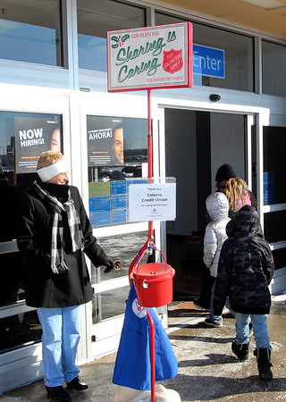 JOHN KLINE | THE GOSHEN NEWS<br /> Salvation Army volunteer bell ringer Deb Garman of Goshen smiles through the cold as customers enter the Walmart Supercenter at 2304 Lincolnway E. in Goshen early Thursday afternoon.