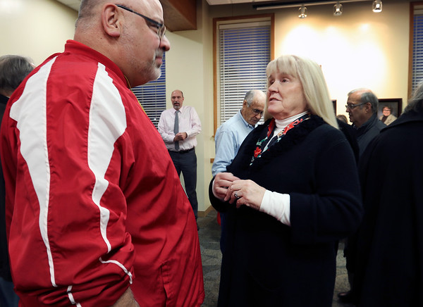 JULIE CROTHERS BEER | THE GOSHEN NEWS<br /> Outgoing Goshen Community Schools board member Cathie Cripe talks with Goshen High School principal Barry Younghans during a community reception Monday night.