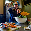JAY YOUNG | THE GOSHEN NEWS<br /> A special sloppy joe mix simmers on the stove while Elkhart County Clubhouse board member Nanne Barkdull, of Goshen, tosses a salad as she prepares a noon meal at the house on Wednesday afternoon.