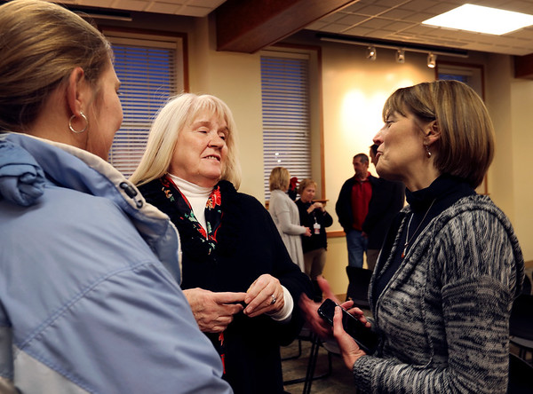 JULIE CROTHERS BEER | THE GOSHEN NEWS<br /> Goshen Community Schools board president Cathie Cripe, center, talks with visitors during a community reception Monday night. Cripe and fellow outgoing board members Bob Duell and Jim Ramer were honored for their service during their final GSC board meeting.