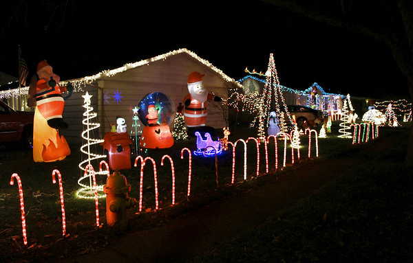 BRENDA DONAT   THE GOSHEN NEWS<br /> Neighbors in West Goshen are celebrating the season at Hickory Place with a variety of colorful Christmas displays.