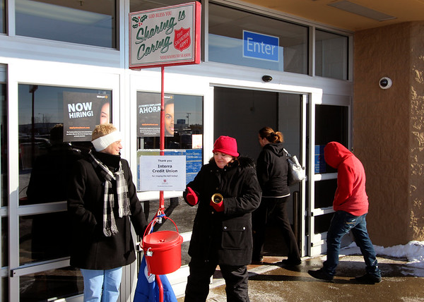 JOHN KLINE | THE GOSHEN NEWS<br /> Goshen bell ringers Deb Garman, left, and Liz Borntrager stand watch over their iconic Salvation Army red donation kettle during a volunteer stint at the Walmart Supercenter at 2304 Lincolnway E. in Goshen early Thursday afternoon.