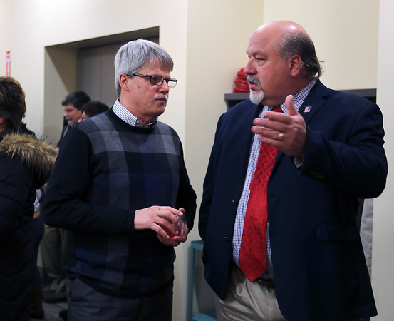 JULIE CROTHERS BEER | THE GOSHEN NEWS<br /> Goshen Community Schools board members Roger Nafziger, left, and Jim Ramer speak prior to the school board meeting Monday night. Ramer, who decided to retire from the board at the end of this year, was honored Monday for his service.