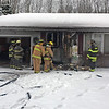 "JOHN KLINE | THE GOSHEN NEWS<br /> Concord and Baugo township firefighters work at house fire at 57011 Sequoia Driven north of C.R. 18 Friday afternoon. Chief Lonnie Camp said the early indications are a drying in the laundry room started the blaze. No one was home at the time. A neighbor reported the fire. ""A neighbor called it in so we ere able to put it out quickly,"" Camp said."