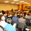 JOHN KLINE | THE GOSHEN NEWS<br /> Richard Aguirre speaks to the Goshen City Council before a crowd of people Tuesday night. Aguirre was speaking in favor of a resolution calling for Goshen residents to unite in safety and tolerance to one another.