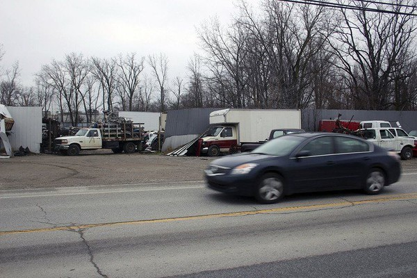 JOHN KLINE | THE GOSHEN NEWS<br /> A car drives past the former Ramirez Salvage & Towing property on the city's east side in this 2015 file photo depicting the significant amount of junk cars, scrap metal and other materials that have since been cleared from the site in preparation for construction of a large stormwater retention basin that will allow for improved stormwater drainage within the Lincoln Avenue/Steury Avenue corridor.