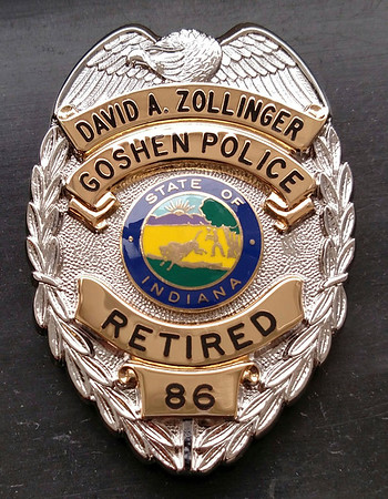 PHOTO CONTRIBUTED<br /> Dave Zollinger received his retirement badge Thursday morning at Olympia Candy Kitchen.
