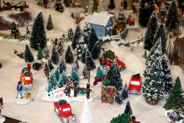 "SHERRY VAN ARSDALL | THE GOSHEN NEWS<br /> A display of miniature homes and businesses with accessories fill a third of the basement in the home of Jeff Ziegler of Wakarusa. He has been collecting pieces to set up the yearly village known as ""Zieglerville"" for 30 years."
