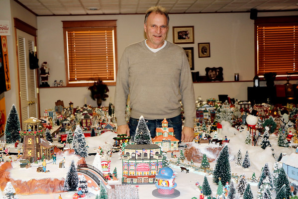 "SHERRY VAN ARSDALL | THE GOSHEN NEWS<br /> Wrigley Field and a concession stand are part of the display of miniature homes and businesses with accessories that fill a third of the basement in the home of Jeff Ziegler of Wakarusa. He has been collecting pieces to set up the yearly village known as ""Zieglerville"" for 30 years."