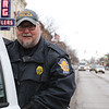 SHEILA SELMAN | THE GOSHEN NEWS<br /> Goshen police officer Dave Zollinger rides his last shift with wife Lisa (not pictured) in downtown Goshen Thursday.