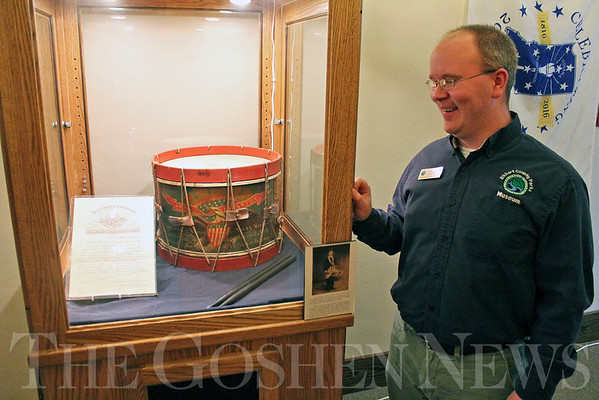 Roger Schneider | The Goshen News<br /> Patrick McGuire, curator of education at the Elkhart County Museum, stands next to the display of the drum carried in the Civil War by 8-year-old Avery Brown.