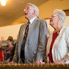 JAY YOUNG | THE GOSHEN NEWS<br /> Pete and Florence Yoder hold hands while singing songs during a Christmas day service at Forks Mennonite Church on Sunday. The Yoders have attended the church for about 65 years. After 159 years, the church is shutting down.