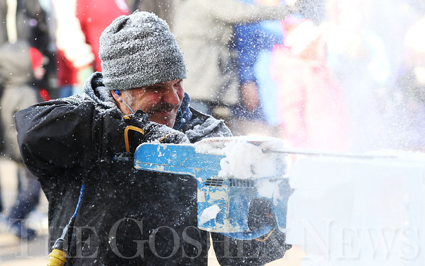 JAY YOUNG | THE GOSHEN NEWS<br /> Danny Bloss, of Niles, Michigan, gets covered in ice shavings while concentrating as he uses a chain saw to carve ice during the annual Ice Festival in Shipshewana on Wednesday.