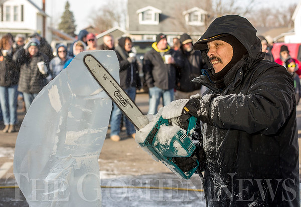 JAY YOUNG | THE GOSHEN NEWS<br /> Alfredo Arroyo, of La Porte, uses a chainsaw to carve his ice sculpture during the annual Ice Festival in Shipshewana on Wednesday.  Arroyo chose to design a pheasant flying out of a field.