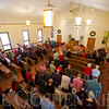 JAY YOUNG | THE GOSHEN NEWS<br /> Members of the congregation stand to pray during a Christmas day service at Forks Mennonite Church on Sunday. After 159 years, the church is shutting down.