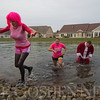 JAY YOUNG | THE GOSHEN NEWS<br /> Kay Hershberger, left, is the first out of the water while Alyssa Reyes and Chad Knisley are close beind after taking a polar plunge into the freezing water on the Waterford Crossing Campus Wednesday afternoon. The trio made the jump into the freezing cold water for charity. While an exact number was unavailable, at least $1000 was raised by the event. The proceeds from the event will go to The  Window.