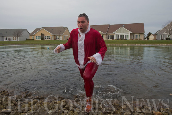 JAY YOUNG | THE GOSHEN NEWS<br /> Waterford Crossing executive director Chad Knisley reacts as he leaves the water after taking a polar plunge into the freezing water of the pond on the Waterford Crossing Campus Wednesday afternoon. Knisley, along with Kay Hershberger and Alyssa Reyes made the jump into the freezing cold water for charity. While an exact number was unavailable, at least $1000 was raised by the event. The proceeds from the event will go to The  Window.