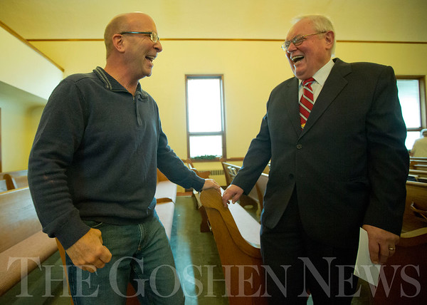 JAY YOUNG | THE GOSHEN NEWS<br /> Middlebury Mike Miller, left, and Pastor Philip Yoder of Forks Mennonite Church, share a laugh after a Christmas Day service as Miller recalls his first memory of attending the church. After 159 years, the church is shutting down.