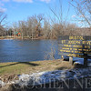 Roger Schneider | The Goshen News<br /> A sign announces the entrance to the public access on the St. Joseph River in Bristol. There is also a park and community building at the location. Another park, Congdon Park, is in the background on the north bank of the river.