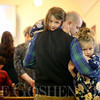 JAY YOUNG | THE GOSHEN NEWS<br /> Shipshewana resident Ryan Yoder holds his daughters Hadley, 5, left, and Harper, 3, during a Christmas day service at Forks Mennonite Church on Sunday. After 159 years, the church is shutting down.
