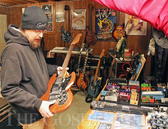 Roger Schneider   The Goshen News<br /> Adam Hart talks about how he restores guitars at his home-based business, Goshen Guitar Works.