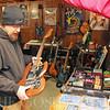 Roger Schneider | The Goshen News<br /> Adam Hart talks about how he restores guitars at his home-based business, Goshen Guitar Works.