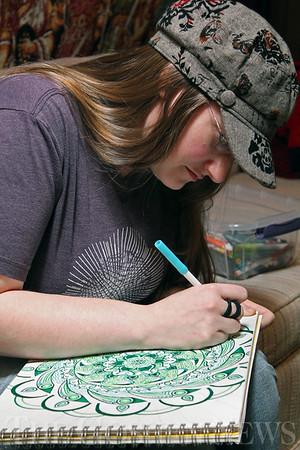 Roger Schneider   The Goshen News<br /> Debbie Gleva works on her artwork in the basement workshop of Goshen Guitar Works.