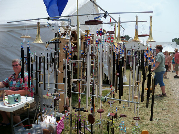 DENISE FEDOROW | THE GOSHEN NEWS<br /> A selection of wind chimes made from old band instrumentsare shown. The artist, John Parker, is shown to the left of photo.