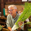 SAM HOUSEHOLDER | THE GOSHEN NEWS<br /> Patricia Oakley, Goshen, talks with a customer about a fennel plant Tuesday at the Goshen Farmer's Market.