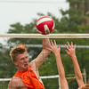 SAM HOUSEHOLDER | THE GOSHEN NEWS<br /> Jamion Parker, of Wakarusa, spikes the ball Friday during the First Friday SandBlast tournament. Lincoln Avenue between Main and Third streets is closed while temporary sand volleyball courts were built for the tournament which continues today.