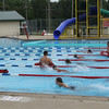 JOHN KLINE | THE GOSHEN NEWS<br /> Girls in the 9 to 10 year old swim division compete under the supervision of lifeguards during the 2014 Goshen Kids' Try-athlon Saturday at Shanklin Park.