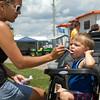 SAM HOUSEHOLDER | THE GOSHEN NEWS<br /> Tiffany Tarlton, of Pierceton, assists son Drake, 2, in eating some ice cream at the Kosciusko County Fair Wednesday in Warsaw.