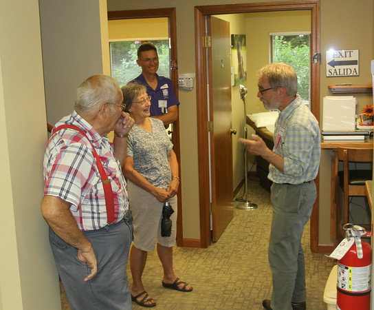 JOHN KLINE | THE GOSHEN NEWS<br /> Dr. James Nelson Gingerich, right, chats with visitors, from left, Ken Mullett, Sheril Mullet, and Don Yost, during the Maple City Health Care Center's 25th anniversary celebration Saturday in Goshen.