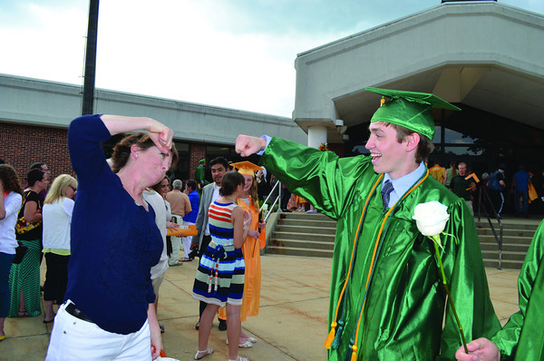 JEN MEIER | THE GOSHEN NEWS<br /> Deb Wigren celebrates with her graduating senior Jack after Northridge High School commencement on Sunday.