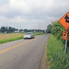 Roger Schneider | THE GOSHEN NEWS<br /> A CAR TRAVELS PAST a sign that warns of the sharp curve ahead on C.R. 40. The curves will be straightened as part of the C.R. 17 extension project.