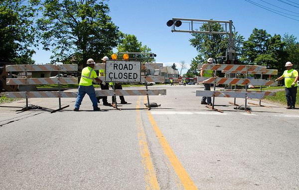SAM HOUSEHOLDER | THE GOSHEN NEWS<br /> Norfolk Southern employees block off the railroad crossing on Lincoln Avenue/S.R. 4 Tuesday so that work could be done to the rails. The crossing is scheduled to be closed until Thursday, according to previous reports.