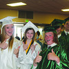 SHERRY VAN ARSDALL | THE GOSHEN NEWS<br /> At left, 2014 seniors Rhyan Simmons, Kayla Laughlin-Sinn and Derek Charles give a thumbs-up as they wait for their turn in the processional at Wawasee High School Saturday.