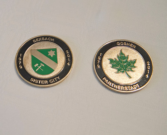 SAM HOUSEHOLDER | THE GOSHEN NEWS<br /> Both sides of the commemrative coins that will be given to German host families during the trip to Bexbach this month are shown.