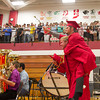 SAM HOUSEHOLDER | THE GOSHEN NEWS<br /> Evan Smith carries Austin Stieglitz into the gymnasium Sunday for the Goshen High School commencement ceremony Sunday.