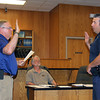 SHERRY VAN ARSDALL | THE GOSHEN NEWS<br /> New Goshen Captain David K. Miller is sworn in Monday by mayor Allan Kauffman during the Board of Works and Public Safety meeting.