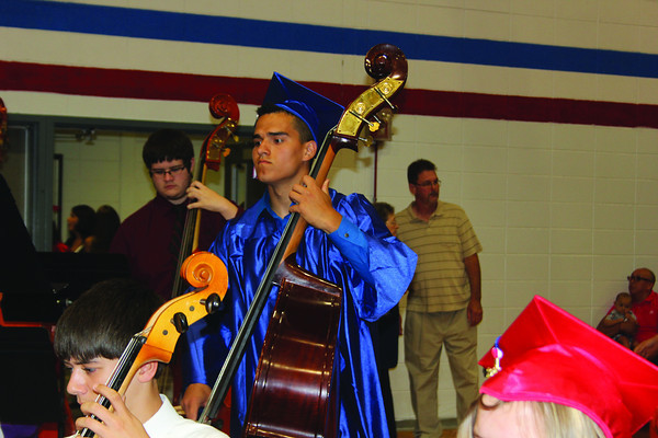 SHERRY VAN ARSDALL | THE GOSHEN NEWS<br /> Senior Carlos Medina plays a bass with West Noble High School band and orchestra during the prelude for graduation Sunday afternoon.